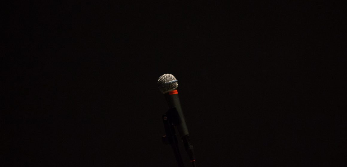 image of a microphone against a black background