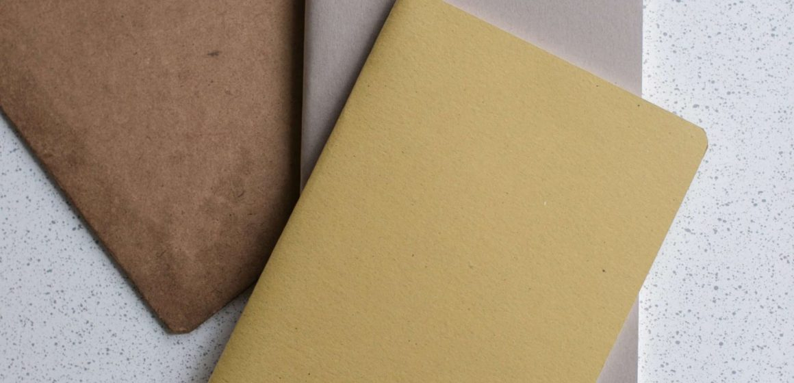 image of brown and gray files and notebooks