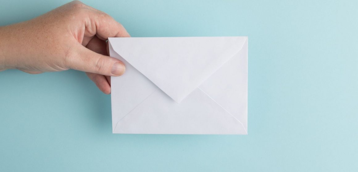 photo of an envelope being passed