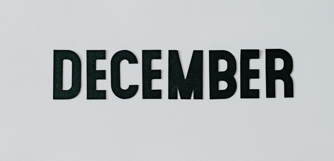 Text in bold black all capitals that say: DECEMBER